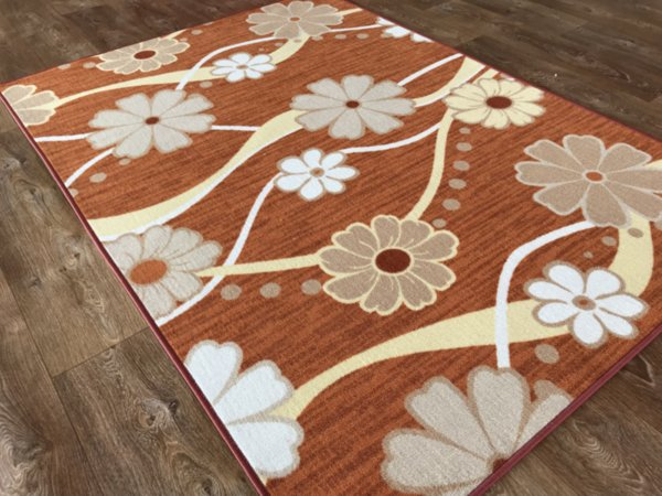 мокетен килим цвете оранж