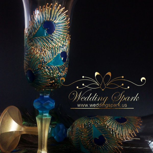 Peacock feathers wedding flutes gold and blue