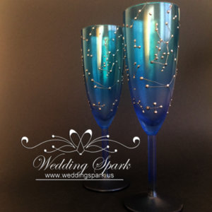 Constellations galaxy wedding flutes in silver and blue