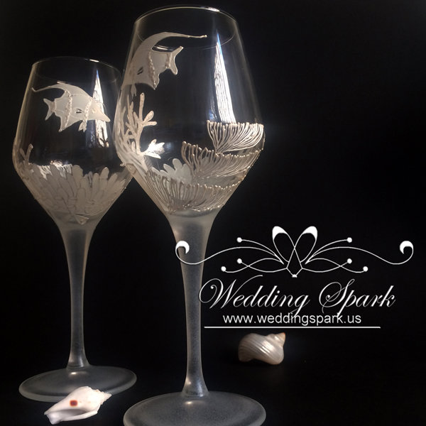 Coral reef wine glasses in white beach wedding theme