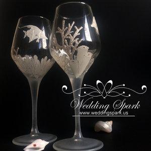 Coral reef wine glasses in white beach wedding theme