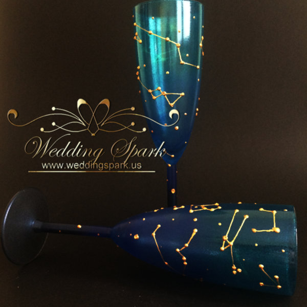 Constellations galaxy wedding flutes in gold and blue