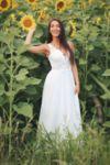 Луксозна дълга рокля в бял цвят