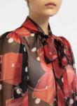 Червена блуза с принт и панделка