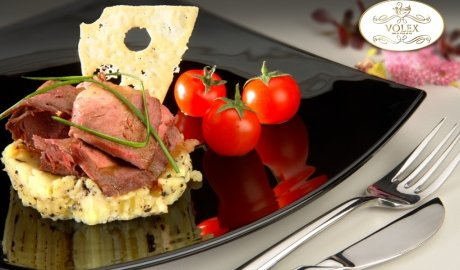 Duck magret on mashed potatoes with truffles and cherry tomatoes