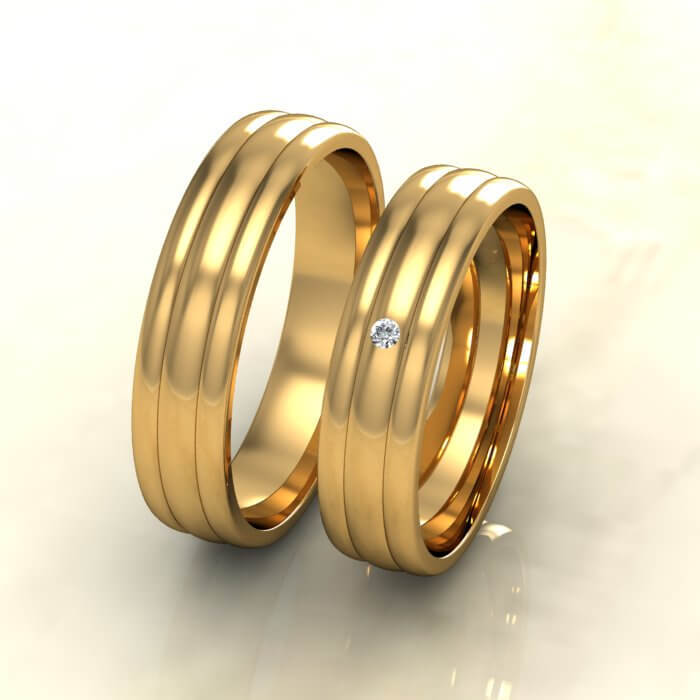 Брачни халки жълто злато с диамант