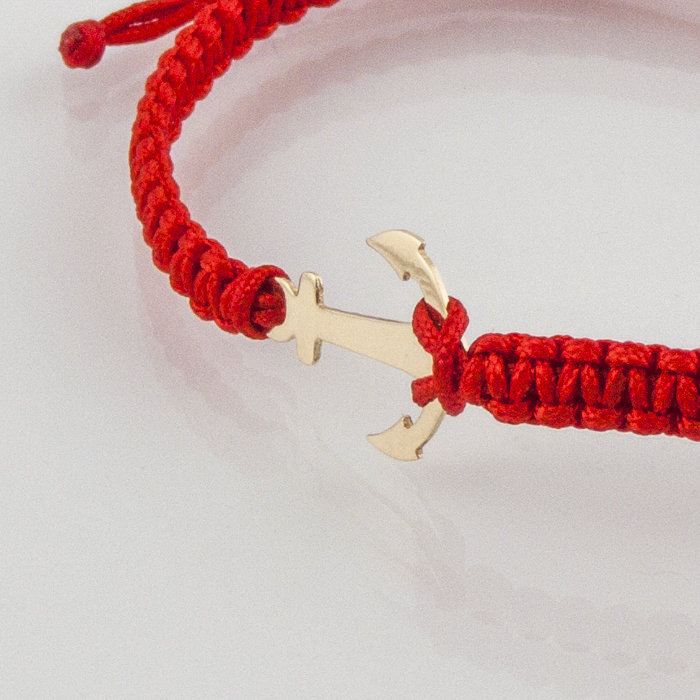Гривна плетена с червен конец жълто злато котва