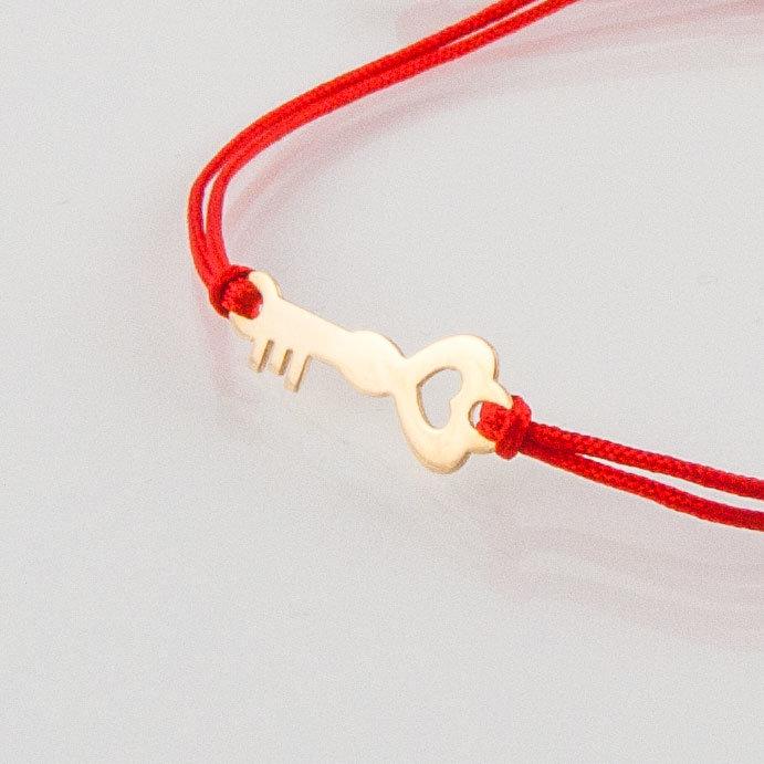 Гривна с червен конец жълто злато ключе