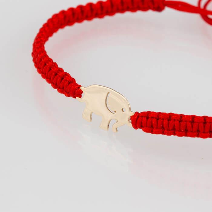 Гривна плетена с червен конец жълто злато слонче