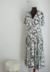 Ефирна дамска рокля в разкроен силует