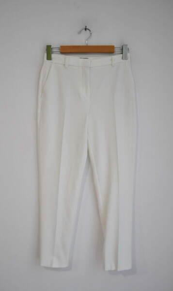Дамски панталон в бяло с джоб
